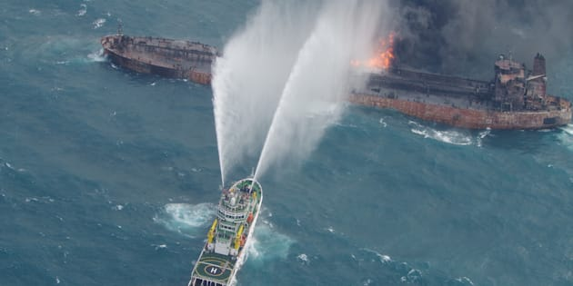 A rescue ship works to extinguish the fire on the stricken Iranian oil tanker Sanchi in the East China Sea, on January 10, 2018 in this photo provided by Japan?s 10th Regional Coast Guard. Picture taken on January 10, 2018.  10th Regional Coast Guard Headquarters/Handout via REUTERS ATTENTION EDITORS - THIS PICTURE WAS PROVIDED BY A THIRD PARTY.
