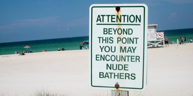 Signage warning beach visitors of nude bathers.