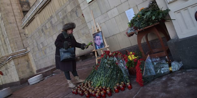 Pepole bring flowers for killed Russian Ambassador to Turkey Andrei Karlov, outside the Foreign Ministry headquarters, in Moscow, Russia, on December 20, 2016. Mr Karlov was shot dead during the launch of a photography exhibition in Ankara by off-duty police officer Mevlut Mert Altintas.(Photo by Dmitry Ermakov/NurPhoto via Getty Images)