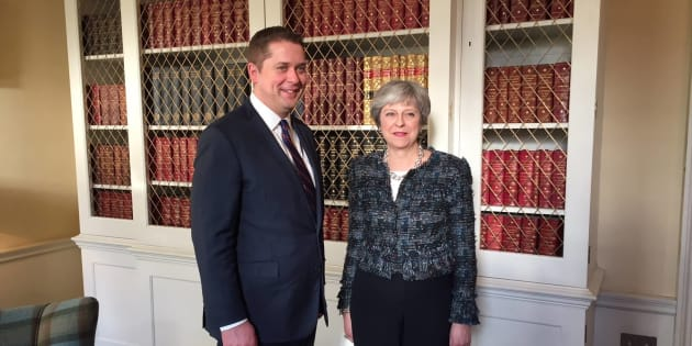Conservative Leader Andrew Scheer smiles for a photo with British Prime Minister Theresa May in a photo posted to Scheer's Facebook on March 8, 2018.