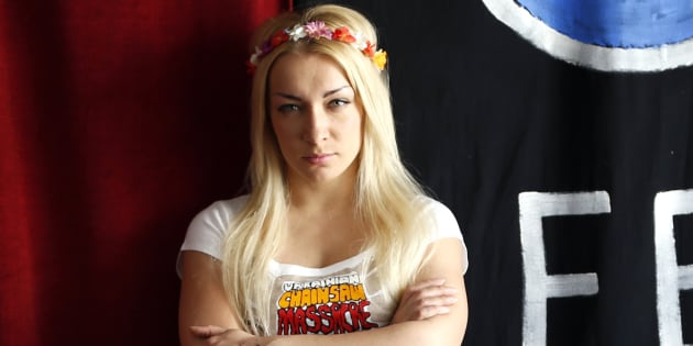 Ukrainian activist Inna Shevchenko, member of the women's rights group Femen, poses during a photo session at their 'training camp' at the Lavoir Moderne Parisen (LMP) in Paris July 8, 2013. Shevchenko has received documents granting her political asylum in France, the press service of the women's rights group reported on Monday.  REUTERS/Charles Platiau  (FRANCE - Tags: POLITICS SOCIETY)