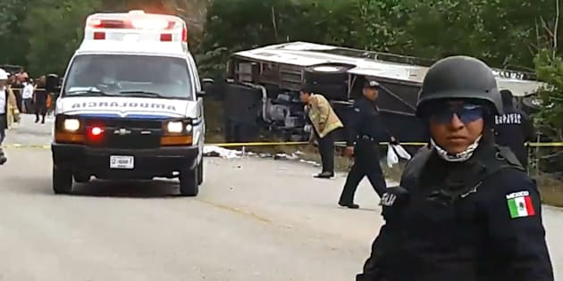 Video grab of Mexican police officers standing guard in the area where a bus driving tourists to Chacchoben archaeological zone overturned in the road between El Cafetal and Mahahual, in Quintana Roo state, Mexico on Dec. 19, 2017.