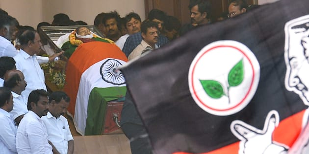 The flag of the All India Anna Dravida Munnetra Kahazagam (AIADMK) party flies near the body of party leader and Tamil Nadu Chief Minister Jayalalithaa Jayaram ahead of her funeral at Rajaji Hall in Chennai.