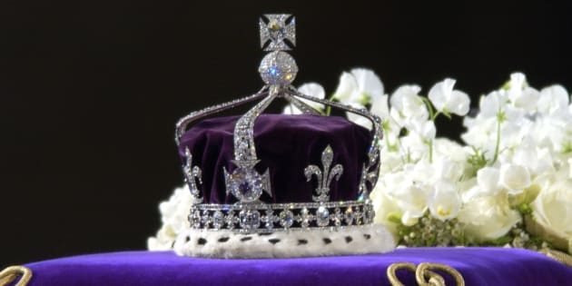A Close-up Of The Coffin With The Wreath Of White Flowers And The Queen Mother's Coronation Crown With The Priceless Koh-i-noor Diamond.