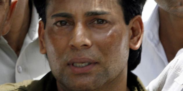 Abu Salem leaves a court in New Delhi May 22, 2007.
