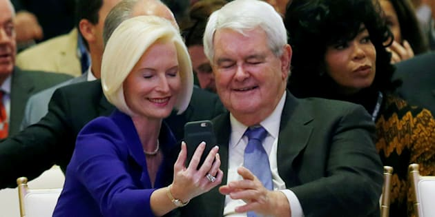 Callista (L) and Newt Gingrich take a selfie at an official ribbon cutting ceremony and opening news conference at the new Trump International Hotel in Washington U.S., October 26, 2016.    REUTERS/Gary Cameron
