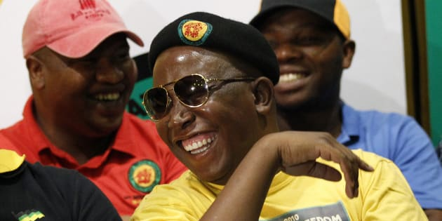 Julius Malema (R) gestures with Pule Mabe during a media briefing at  Luthuli House in Johannesburg March 5, 2012.