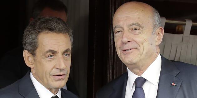 Nicolas Sarkozy et Alain Juppé à Paris, septembre 2015. REUTERS/Jacky Naegelen