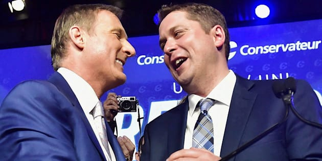 Andrew Scheer, right, is congratulated by Maxime Bernier after being elected the new leader of the federal Conservative party at the Tory leadership convention in Toronto on May 27, 2017.