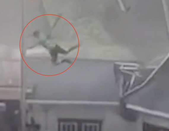 Video: Powerful storm throws man into building