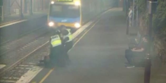 Melbourne police save woman from train with seconds to spare