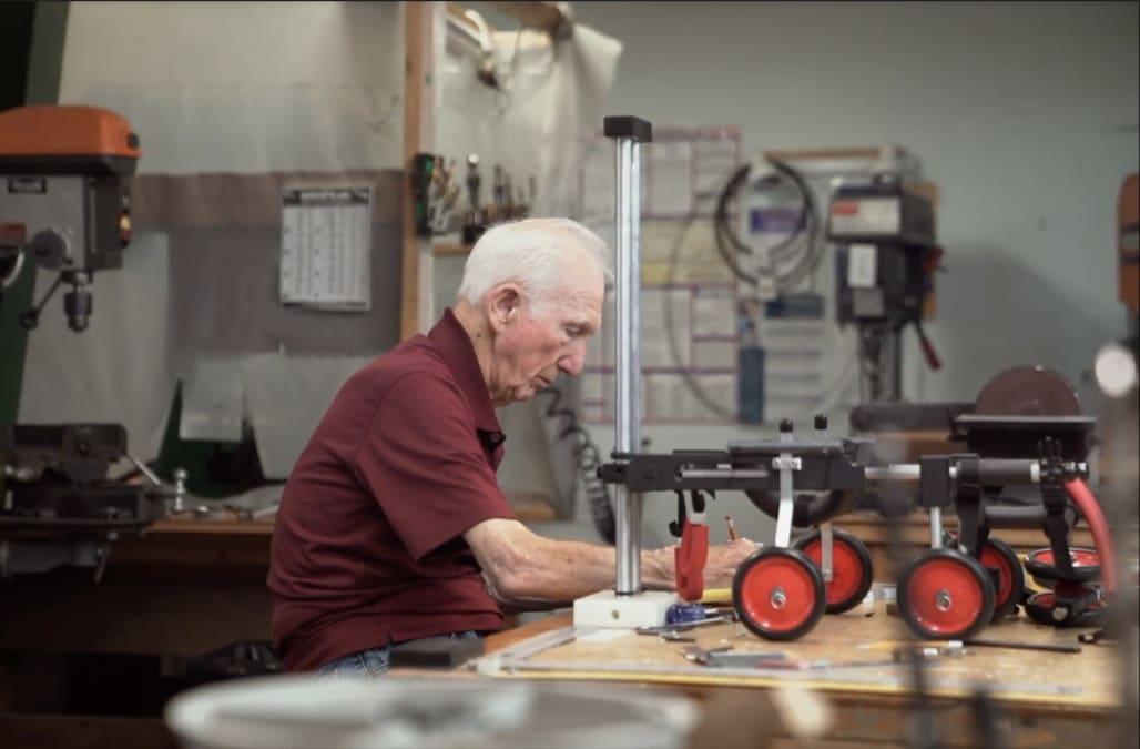 """This 92-year-old retired veterinarian has been making """"wheelchairs"""" for paralyzed animals for over 60 years"""
