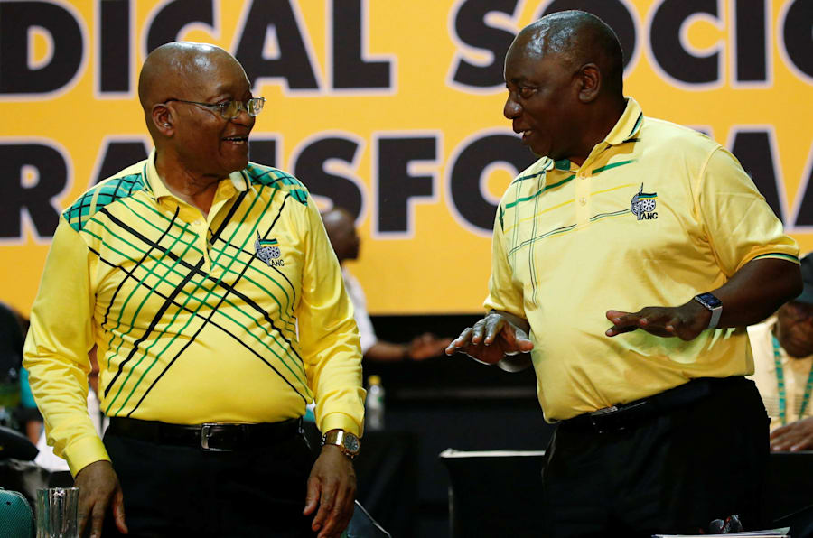 Deputy President Cyril Ramaphosa (R) chats with President Jacob Zuma during the 54th national conference of the ANC. December 16, 2017.
