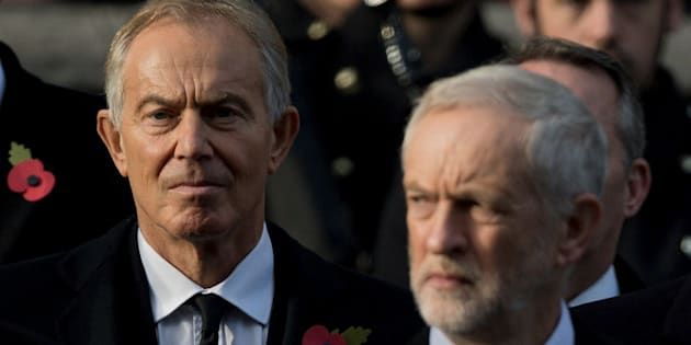 Former British prime minister Tony Blair (L) and Britain's opposition Labour Party Leader Jeremy Corbyn take part in the Remembrance Sunday ceremony at the Cenotaph on Whitehall, London, on November 13, 2016.  Services are held annually across Commonwealth countries during Remembrance Day to commemorate servicemen and women who have fallen in the line of duty since World War I. / AFP / JUSTIN TALLIS        (Photo credit should read JUSTIN TALLIS/AFP/Getty Images)