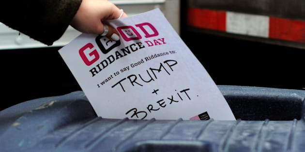 "A paper with ""Trump + Brexit"" written on it goes into the bin for shredding during ""Good Riddance Day"" in Times Square, New York City, December 28, 2016.  REUTERS/Darren Ornitz"