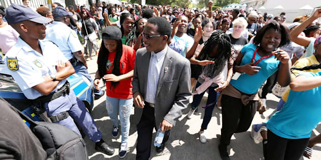 GRAHAMSTOWN, SOUTH AFRICA; OCTOBER 19: Rhodes University vice-chancellor Dr Sizwe Mabizela with students protesting over an increase of tuition fees.