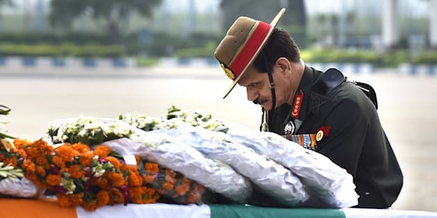 Army Chief Dalbir Singh paying tributes to two Army jawans killed in an encounter with militants in in Jammu and Kashmir in July.