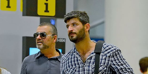 BARCELONA, SPAIN - JULY 29:  George Michael and his boyfriend Fadi Fawaz are seen at Barcelona El Prat Airport on July 29, 2012 in Barcelona, Spain.  (Photo by Bauer-Griffin/GC Images)