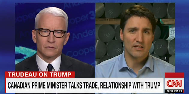 "Anderson Cooper and Prime Minister Justin Trudeau are shown in a screegrab from ""Anderson Cooper 360"" on March 12, 2018."