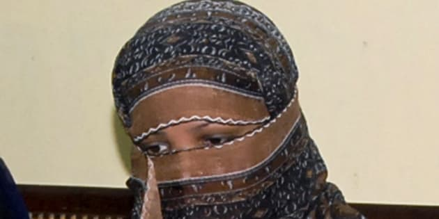In this Nov. 20, 2010, file photo, Aasia Bibi, a Pakistani Christian woman, listens to officials at a prison in Sheikhupura near Lahore, Pakistan.