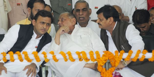 LUCKNOW, INDIA - NOVEMBER 3: Uttar Pradesh Chief Minister Akhilesh Yadav talking to his father and SP chief Mulayam Singh yadav while Shivpal Yadav and others look on during a 'Vikas Rath Yatra', flagged off by Samajwadi Party President Mulayam Singh, at La Martiniere Ground on November 3, 2016 in Lucknow, India.
