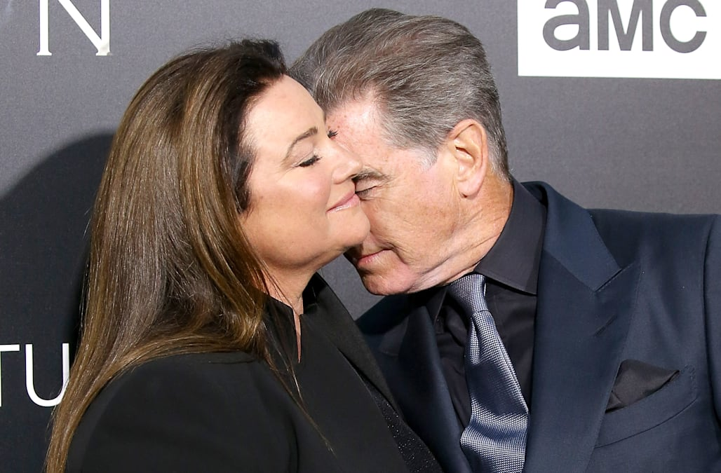 Pierce Brosnan and wife Keely Shaye Smith pack on the PDA ...