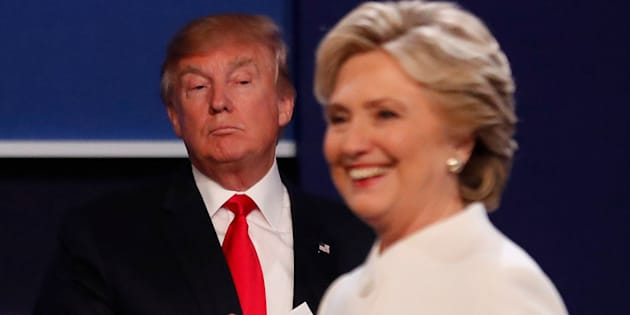 Republican U.S. presidential nominee Donald Trump and Democratic U.S. presidential nominee Hillary Clinton finish their third and final 2016 presidential campaign debate at UNLV in Las Vegas, Nevada, U.S., October 19, 2016.      REUTERS/Mike Blake