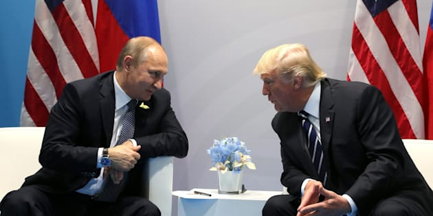 Russia's President Vladimir Putin (L) and US President Donald Trump (R) hold a bilateral meeting on the sidelines of the  G20 summit in Hamburg, Germany, on July 7, 2017.