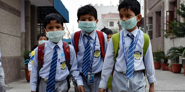 School students have started wearing face masks to school after pollution levels increased after Diwali on 4 Nov 2016 in Delhi.