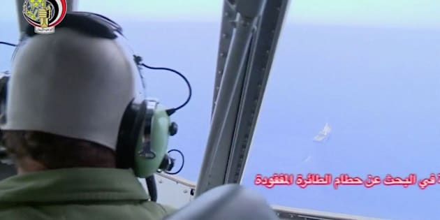 A pilot looks out of the cockpit during a search operation by Egyptian air and navy forces for the crashed EgyptAir plane in the Mediterranean Sea.