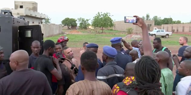 Police with four people rescued from the Le Campement Kangaba resort following an attack where gunmen stormed the resort in Dougourakoro, to the east of the capital Bamako, Mali in this still frame taken from video June 18, 2017.