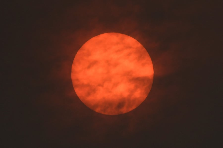 The sun is seen after dawn after the Met Office reported that storm Ophelia has drawn dust north from the Sahara, near Exeter, Britain October 16, 2017. REUTERS/Toby Melville     TPX IMAGES OF THE DAY