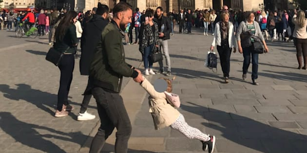 Brooke Windsor took this photo outside Notre Dame just an hour before it was engulfed by fire. Now she wants to find the man and child.