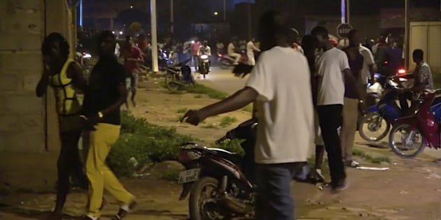 Restaurant customers run in the street following an attack by gunmen on a restaurant in Ouagadougou, Burkina Faso, in this still frame taken from video August 13, 2017.