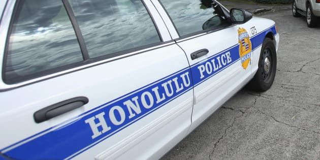 Police cars are seen parked in front of Roosevelt High School after a shooting incident in Hawaii Jan. 28, 2014. The FBI is investigating four Honolulu police officers who are accused of forcing a man to place his mouth on a urinal inside a public restroom.