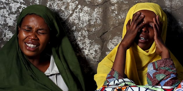 Two women weep and pray for their relative Ndayizeye Janvier Abdul, 36, who was killed by the Imbonerakure, the feared youth wing of the governing party in Burundi.