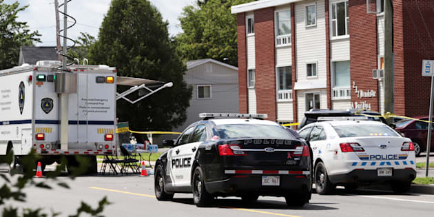 Fredericton Police and Royal Canadian Mounted Police (RCMP) investigate apartment complex which was the scene of a shooting incident in Fredericton, New Brunswick, Canada August 10, 2018.