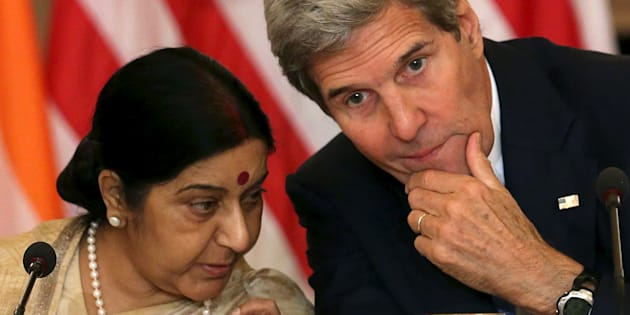 US Secretary of State John Kerry (R) chats with  External Affairs Minister Sushma Swaraj (L).   REUTERS/Gary Cameron