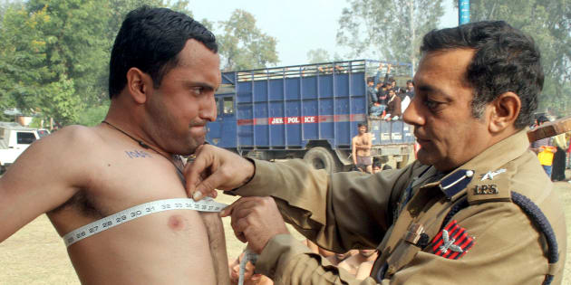 File photo of a police officer measuring the chest of a man during a recruitment drive in J&K.