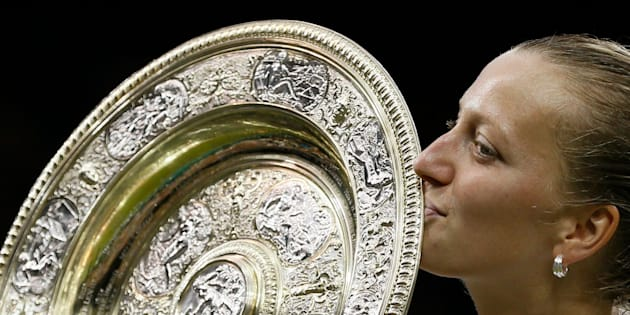 Petra Kvitova of Czech Republic kisses the winner's trophy, the Venus Rosewater Dish, after defeating Eugenie Bouchard of Canada in their women's singles final tennis match at the Wimbledon Tennis Championships in London July 5, 2014.     REUTERS/Stefan Wermuth (BRITAIN  - Tags: SPORT TENNIS)