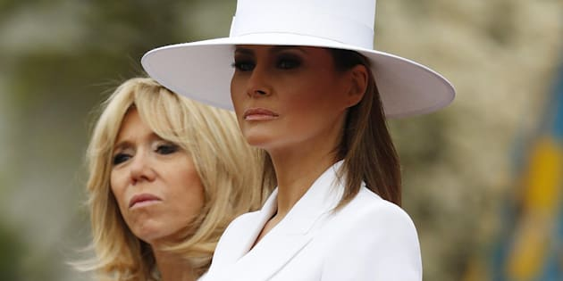 epa06689156 US First Lady Melania Trump (R) with French First Lady Brigitte Macron (L) during an arrival ceremony at the White House in Washington, DC, USA, 24 April 2018. President Macron will be in DC for three days for a state visit at the White House and an address to a joint session of Congress on 25 April.  EPA/SHAWN THEW