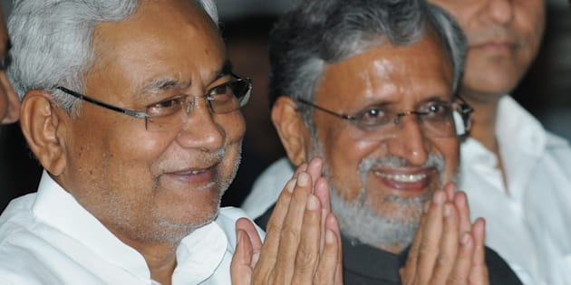 Bihar Chief Minister Nitish Kumar with Deputy Chief Minister Shushil Mody at Oath ceremony of Ministers at Raj Bhawan, on July 29, 2017 in Patna.