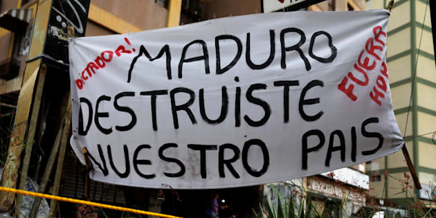 A sign reading, 'Maduro: You destroyed our country' is seen during a rally against Venezuelan President Nicolas Maduro's government in Caracas, Venezuela, July 19, 2017.  REUTERS/Carlos Garcia Rawlins