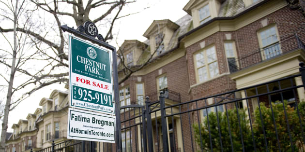 A for sale sign outside a rowhouse in Toronto. After showing signs of a rebound over the spring and summer months, Canada's national housing market has slipped back into downturn mode, two new reports released Thursday show.