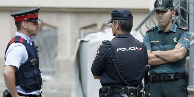 Representantes de los tres cuerpos de seguridad del Estado que actúan en Cataluña.