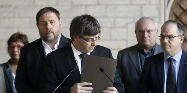 El president, Carles Puigdemon, junto a Oriol Junqueras y Jordi Turull
