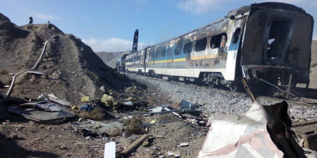 This picture released by Iranian Fars News Agency shows the scene of two trains collision about 150 miles (250 kilometers) east of the capital Tehran, Iran, Friday, Nov. 25, 2016. An Iranian official has told state TV that the death toll from a train collision in the country's north has increased to 31. The provincial governor, Mohammad Reza Khabbaz, says that so far 31 bodies have been found at the site of the crash on Friday morning. (Saeed Esmaeilpour, Fars News Agency via AP)