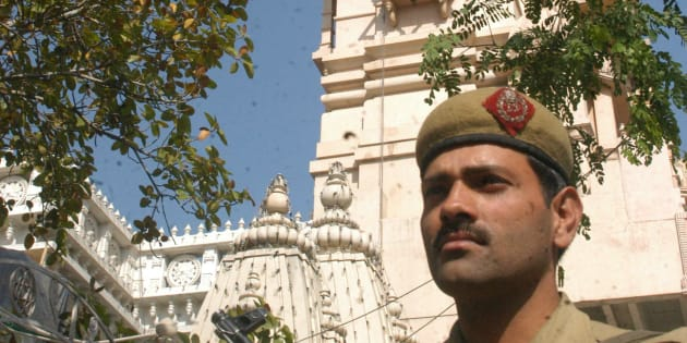 A Policeman guards the entrance of the Chattarpur Temple at Chattarpur Enclave, New Delhi.