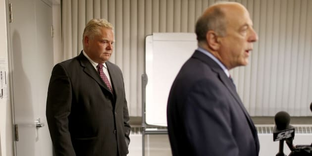 Doug Ford listens to Dr. Rueben Devlin during the press conference about his brother's cancer fight at Humber River hospital on Sept. 10, 2014.