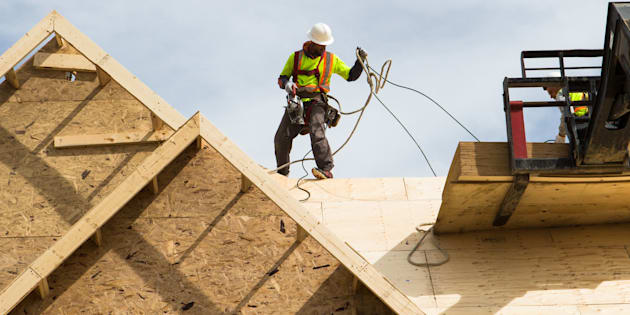 Workers build the roof of a house under construction in Brampton, Ont, Sat., May 20, 2017. The unemployment rate stayed at its 43-year low of 5.6 per cent last month as the economy closed out 2018 with the addition of 9,300 net new jobs.